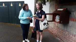 Kate Canning with the first 'Little Free Library' client, Eve moments after Paddy Doyle from the Community Centre erected it on Friday Oct 18th 2019